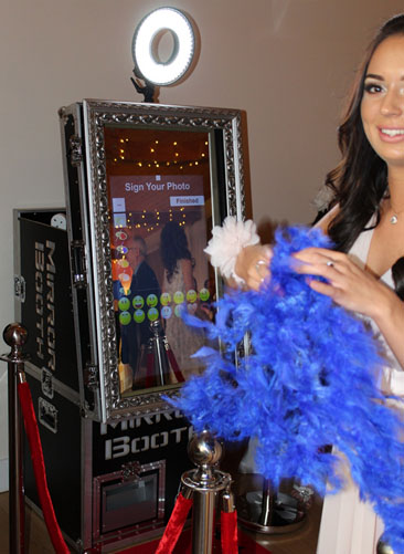 Bride enjoying a photo booth magic mirror at her wedding