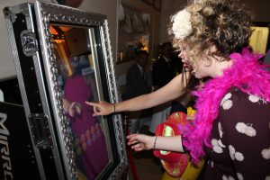 Guests leaving a message at a wedding using our touch screen magic mirror photo booth in London hotel